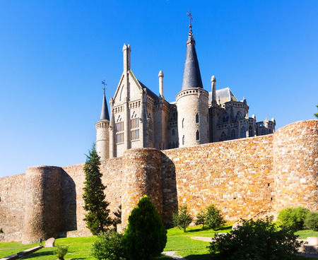 episcopal: Ancient town walls  and Episcopal Palace of Astorga in summer. Spain Editorial