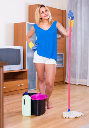 ordinary woman: Ordinary woman with mop and bucket in domestic interior Stock Photo