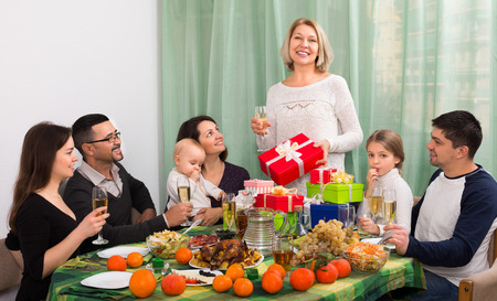 granny and grandad: mature woman celebrating jubilee with big family at festive table