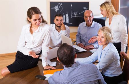 break in: Positive smiling colleagues having break in office. Selective focus Stock Photo