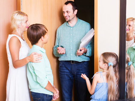 threshold: Smiling man coming at threshold with visit to friends family