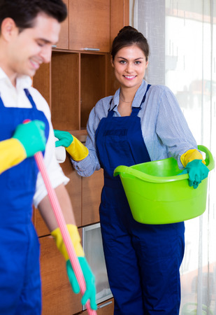 armenian woman: Portrait of cleaners in overalls with supplies Stock Photo