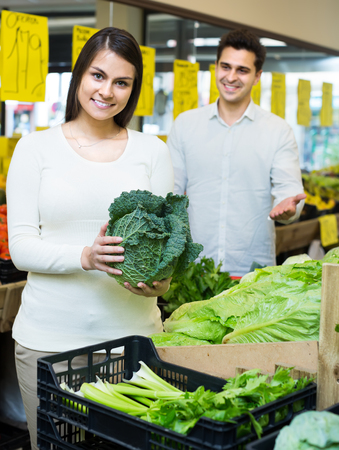spouses: Happy young spouses choosing ecological veggies in grocery store