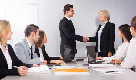 warmly: The head of office warmly greeting new european business partner Stock Photo