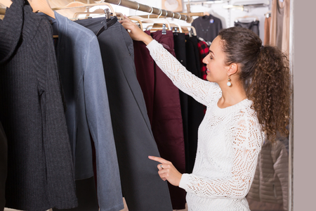 breeches: Ordinary female customer selecting breeches at the store Stock Photo
