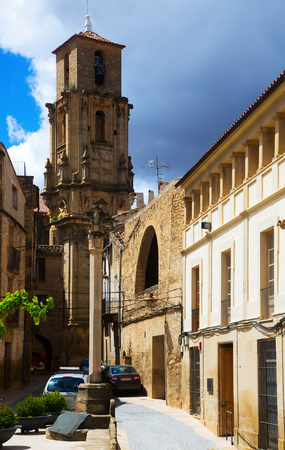 belltower: Belltower of Church of the Assumption in sunny summer time. Calaceite,  Teruel Stock Photo