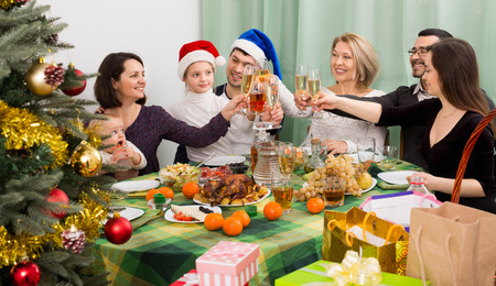 relatives: Relatives joyfully celebrate Christmas at  table in home