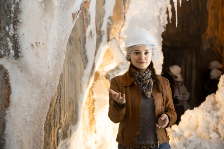 saltmine: Smiling young female in jacket and helmet on salt-mine excursion at Cardona