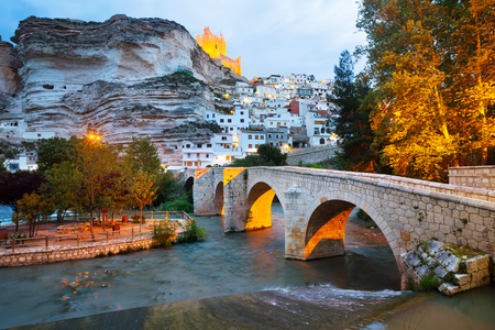 dusk view of Alcala del Jucar with   river and bridge. Province of Albacete, Spain