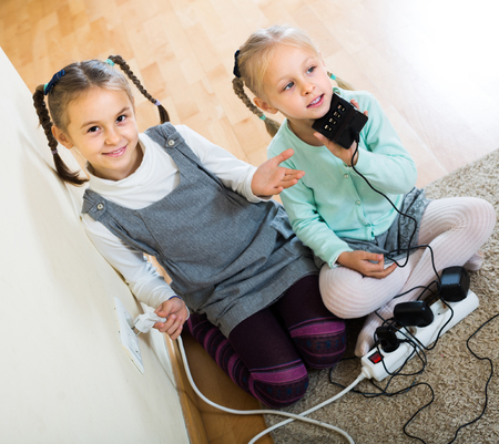 sockets: positive  children playing with sockets and electricity indoors