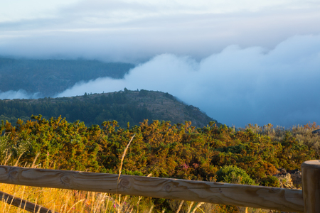 galicia: Fog over wooded mountains in Galicia, Spain Stock Photo