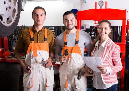 crew: Portrait of smiling auto service crew at garage