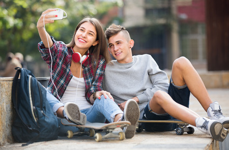 16s: Teenage friends taking photo of themselves for selfie with phone Stock Photo