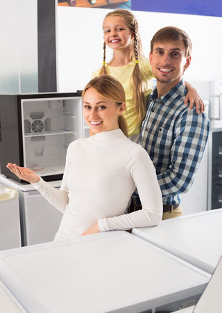 household appliance: portrait of cheerful family shopping in household appliance shop Stock Photo