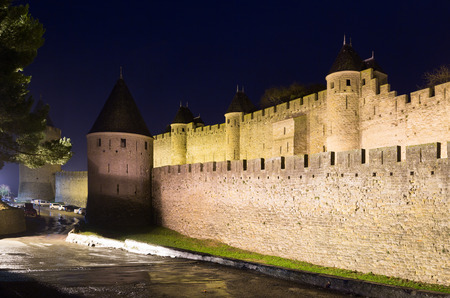 antiquary: fortified city in night time.  Carcassonne, France Stock Photo