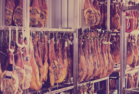 jamon: Spanish jamon joints hanging at jamon factory Stock Photo