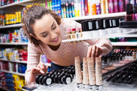 beauty store: Portrait of cheerful female brunette shopping in beauty store