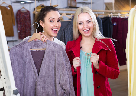 Ordinary  caucasian women shopping winter outwear at the apparel store Stock Photo