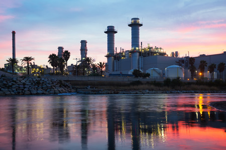 commercial recycling: Sunset view of  industry plant and river in evening Stock Photo