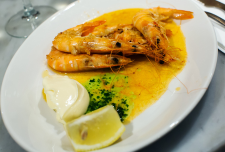 souse: Nicely served prawns with lemon and souse in cafe Stock Photo