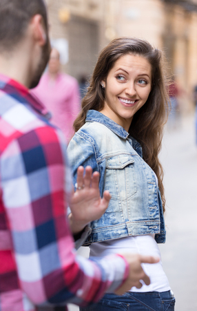 persecution: Attractive girl smiling back at nice-looking male stranger Stock Photo