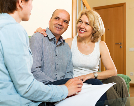 private insurance: Elderly couple discussing details of private insurance with friendly agent