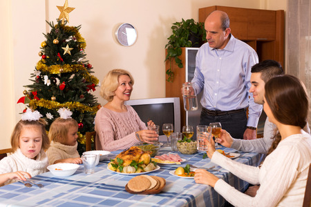 three generations of women: parents with adult kids and grandchildren in holiday Stock Photo