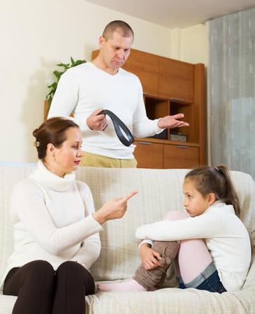 ordinary parents berating daughter at home