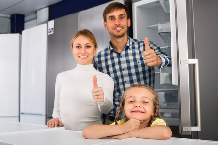 household appliance: cheerful family shopping in household appliance shop Stock Photo