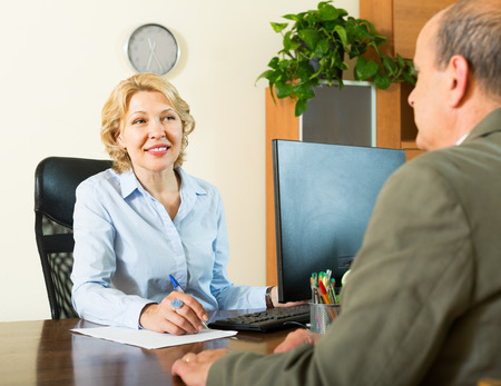 make public: Friendly smiling public notary helping senior client to make a will