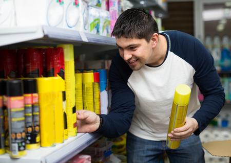 male killer: Male customer choosing cockroach killer in shopping mall