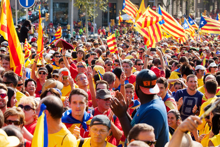 demanding: BARCELONA, SPAIN - SEPTEMBER 11, 2014: Rally demanding independence for Catalonia in 300th anniversary of loss of independence. Barcelona, Spain Editorial