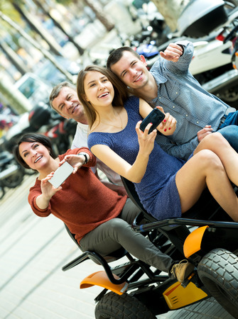 Beautiful family sitting in grand tour electric and taking pictures of Europenian city Stock Photo
