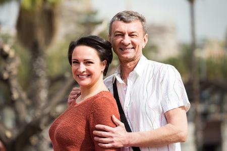 Portrait of joyful smiling mature couple enjoying fine day outdoors Stock Photo