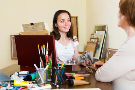 slavs: Girl painting  portrait of woman artist  at workshop