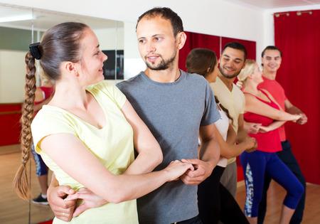 latino dance: Positive young couples dancing Latino dance
