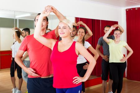 latino dance: positive people dancing Latino dance in class Stock Photo
