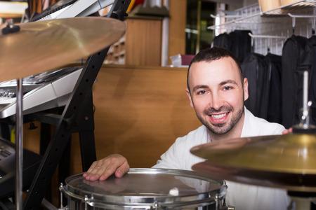 buyer: Male buyer choosing drums in music shop
