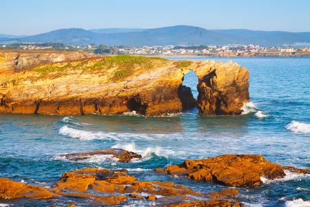 backwater: Natural arch at As Catedrais beach in  evening time. Atlantic Ocean coast of Spain