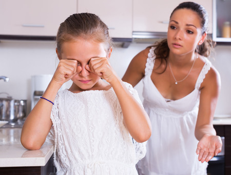berate: Crisis of motherhood: young woman preaching unhappy daughter