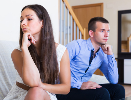 Unhappy young spouses having bad argue in livingroom