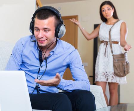 spending money: Upset woman suspecting spouse spending money on games online