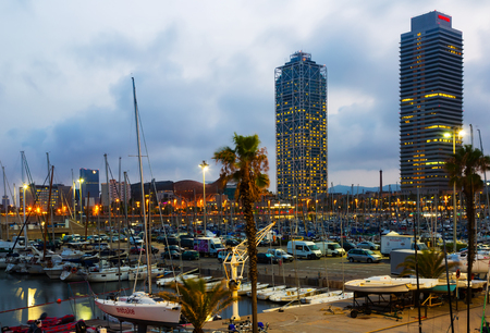 summer olympics: BARCELONA, SPAIN - AUGUST 7, 2015:  Twilight view of Port Olimpic in Barcelona, Spain. It hosted the sailing events for the 1992 Summer Olympics Editorial