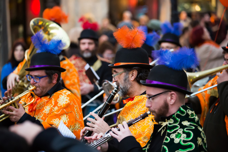 carnaval: BARCELONA, SPAIN - FEBRUARY 4, 2016:  Musicians at Spanish Carnaval at Barcelona in evening time.  Catalonia, Spain