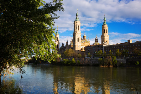 ebro: Dome and bell towers of  Cathedral of Our Lady of the Pillar in sunny evening. Zaragoza, Aragon