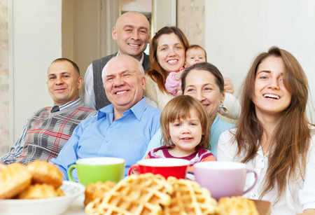 three generations: happy three generations family communicate over tea at home Stock Photo