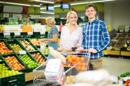 food shop: russian couple buying sweet fruits in local food shop