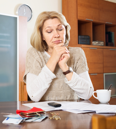 parsimony: Housewife thinking about  family budget at  home Stock Photo