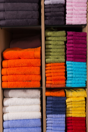accurately: stack of accurately lying bad towels on shop shelves in textile department