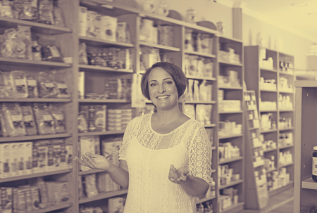 biologically: Portrait of smiling mature woman in biologically active dietary supplements store Stock Photo
